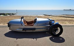 Classic Silver Morgan 3 wheeled Motor Car Parked on Seafront Promenade. stock photo