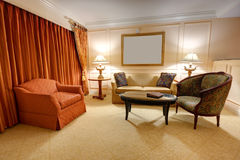 Classic sitting room. With sofa, armchair, table and lamps Stock Photography