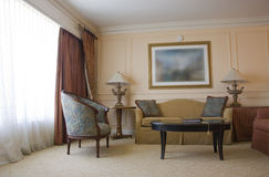 Classic sitting room. With sofa, armchair, table and lamps Royalty Free Stock Photography