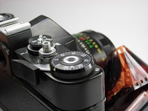 Classic SLR camera macro with film. Classic SLR camera isolated on white Royalty Free Stock Images