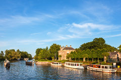 Classic small cruise boats on the famous Dutch river Vecht Royalty Free Stock Images