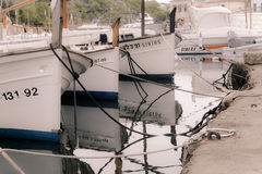Classic small wood boats, llauts, moored in harbor Royalty Free Stock Images
