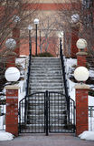Classic Snow Covered Stairway and Lamp Pillars Royalty Free Stock Image