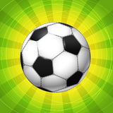 Classic Soccer ball. Glowing with the rays. vector illustration Stock Illustration