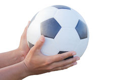 Classic soccer ball in male hands. Stock Photos