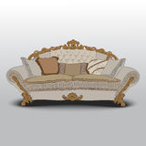 Classic sofa. With carved wooden elements, soft pillows Stock Photos