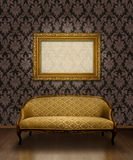Classic sofa and frame. Classic antique sofa and gold plated frame in room with chocolate brown damask pattern wall stock illustration