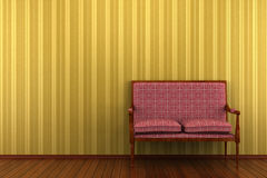 Classic sofa in front of yellow striped wall royalty free stock photo