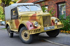 Classic Soviet car GAZ-69. Vintage perfectly restored Soviet classic military car GAZ-69 at a car show in Gdansk Oliwa, northern Poland. Camouflage painting royalty free stock image
