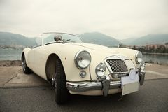 Classic sport white car. Vintage sport car near sea Royalty Free Stock Images