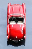 Classic Sports Car. Model of a classic red sports car on a silver background Royalty Free Stock Images