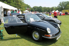 Classic sports car. Classic black Porsche 911 sports car on display outdoors in a lineup among other sports cars. 2013 Belle Macchine dItalia car event stock photo