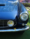 Classic sports car headlamp. Classic italian sports car headlamp grill and bumper Royalty Free Stock Images