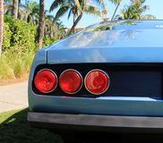 Classic sports car tail lights. Classic Italian sports car tail lights from the 1970s. Ferrari 365 gtc/4 at car event royalty free stock photos