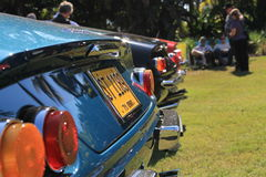 Classic sports car tail lights lineup. Ferrari lineup. Classic Italian sports car tail lights and lined up. 1970s. Ferrari 365 gtb Daytona cars at car event stock photography