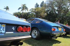 Classic sports car tail lights and rear deck. Classic Italian sports car tail lights and sloping trunk from the 1970s. Ferrari 365 gtc/4 at car event stock photos