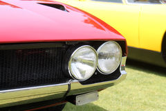 Classic sports car twin headlamps Stock Images
