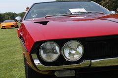 Classic sports car twin headlamps royalty free stock images
