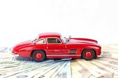 A classic sports car of the year 1954 of red color over euro bil. Ls with white background Stock Photos