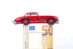 A classic sports car of the year 1954 of red color over euro bil royalty free stock images