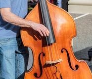 Classic standup bass played on the street Royalty Free Stock Images