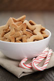 Classic star cookies in white bowl with candy cane Stock Image