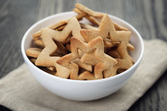 Classic star cookies in white bowl Stock Images