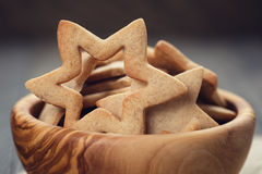 Classic star cookies in wood bowl Stock Photos
