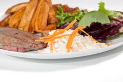 Classic steak and chips meal with home-made coleslaw and salad Stock Photo