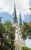 Classic Steeples Beyond Trees Royalty Free Stock Photos