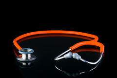 Classic stethoscope laying flat isolated on black Stock Photos