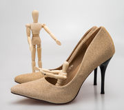 Classic stiletto high heels shoes in golden texture design. Stock Photography