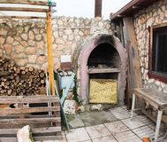 Classic stone barbecue in private home royalty free stock image