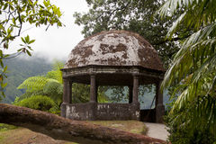 Classic stone gazebo in botanical garden. Classic antique old benche in a romantic atmosfrere Stock Image