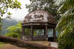 Classic stone gazebo in botanical garden Stock Image