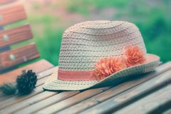 Classic straw hat on a bench stock photos