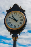 Classic Street Clock on a Warm Summer Day Close Up Royalty Free Stock Images