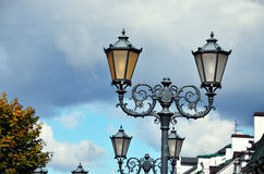 Classic street lantern in modern city Stock Images