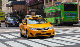 Classic street view of yellow cabs in New York city Stock Photos