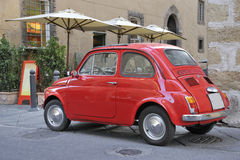 Classic streetscene with red fiat car