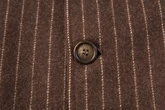 Classic striped fabric with brown button Royalty Free Stock Photography