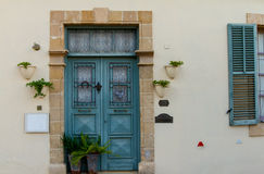 Classic style cyan wooden door house entrance and window Royalty Free Stock Photos