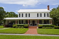 Classic style home. Well kept home with brick sidewalk royalty free stock photo