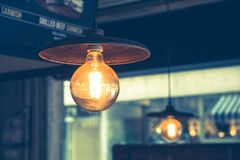 Classic style light bulbs hanging from ceiling Royalty Free Stock Images