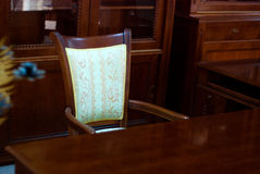 Classic Style Mahogany Cabinet. Chair And Table Royalty Free Stock Photos