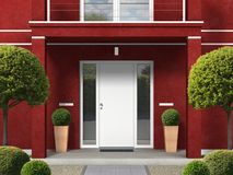 Classic style maroon house facade with entrance portal and front door stock images