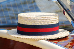 Classic sun hat on a classic boat Royalty Free Stock Photo