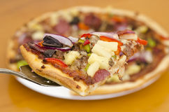 Classic supreme pizza slice closeup Royalty Free Stock Images