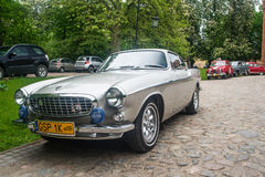 Classic Swedish car Volvo P1800. Classic Swedish automobile Volvo P1800 of James Bond from 007 at a car show in Rzucewo, northern Poland Stock Image