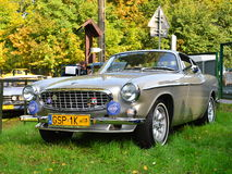 Classic Swedish car Volvo P1800. Beutiful perfectly restored Swedish vintage classic car Volvo P1800 at a car show in Gdansk Oliwa, northern Poland. Yellow royalty free stock images